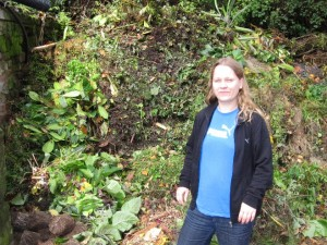 Lead scientist of the study, Dr. Carola Petersen, in front of an enormous compost heap - one of the C. elegans collection sites