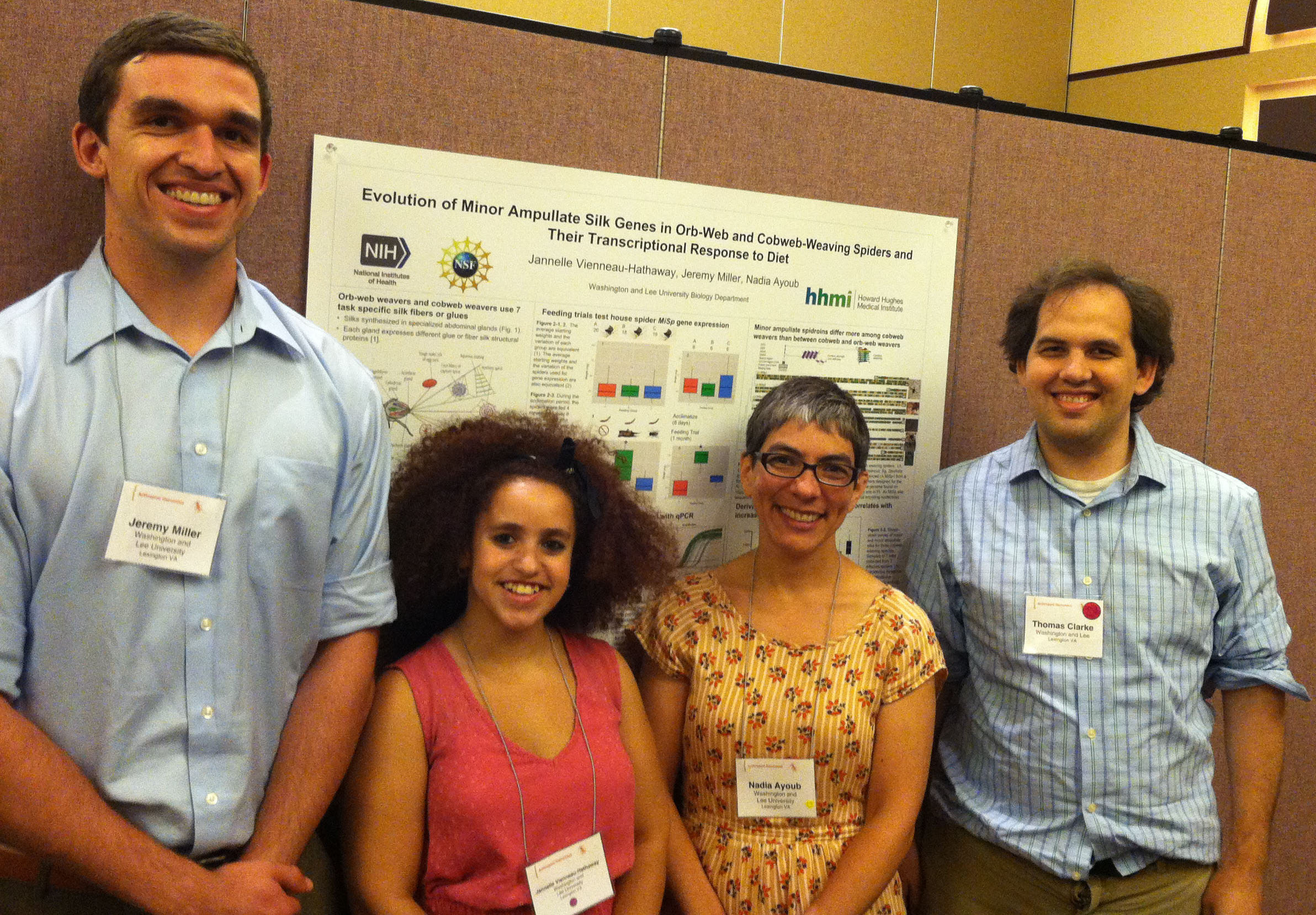 Undergraduates, Jeremy Miller (far left) and Jannelle Vienneau-Hathaway (second from left and first author), worked with Nadia Ayoub (second from right) on cobweb spiders' minor ampullate silk genes. Bioinformatics specialist, Toby Clarke (far right), also co-authored the recent publication. Pictured at Arthropod Genomics Symposium, 2015