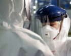 Checking_Personal_Protective_Equipment_(PPE)_in_the_fight_against_Ebola_(15650272810)