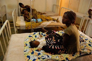 Babies receiving treatment for malaria. Image from Wikimedia Commons