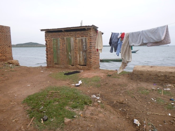 Pit latrines on the shore of Lake Victoria in Bugoto. Photo credit: Lauren Carruthers