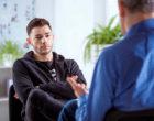 Man listening to therapist.